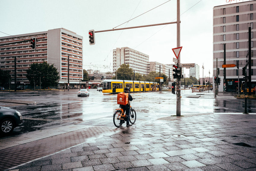 Less traffic after rain The Street Photographer - 2018 EyeEm Awards Urban Geometry Bicycle Building Building Exterior Built Structure Car City City Life City Street Day Land Vehicle Mode Of Transportation Office Building Exterior One Person Outdoors Rain Real People Riding Road Sky Street Streetphotography Transportation Urban