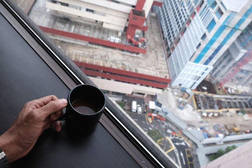 development Development Contruction Zone Coffee Coffee Cup Human Hand Human Body Part City Transportation One Man Only People Building Exterior Architecture The Graphic City