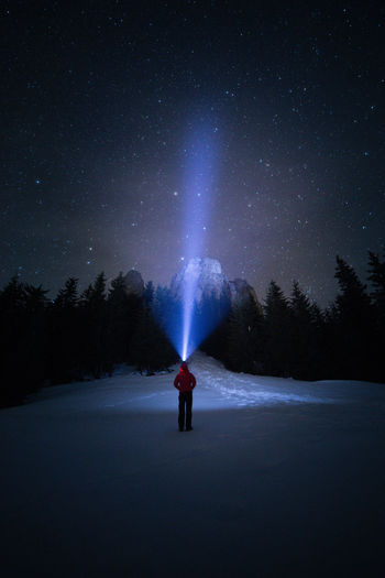 Night One Person Real People Scenics - Nature Star - Space Tree Sky Space Rear View Cold Temperature Beauty In Nature Astronomy Snow Leisure Activity Lifestyles Nature Silhouette Unrecognizable Person Flashlight Nightphotography Nature Mountain People People Watching International Women's Day 2019