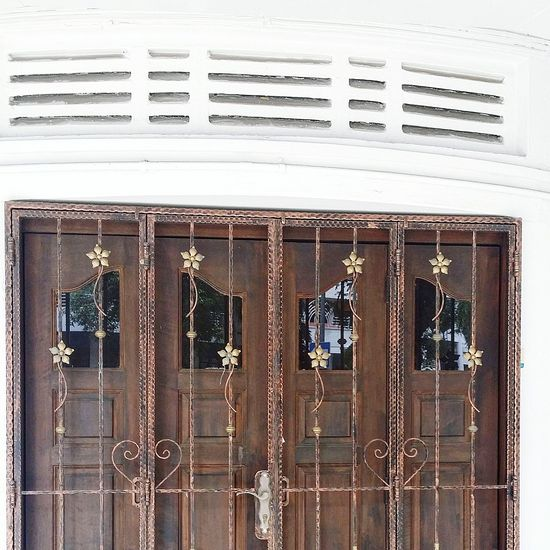 A rather charming Door and Gate Design Flower Motif Architecture Residences Tiong Bahru Singapore