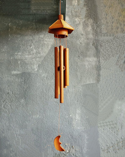 Close-up of electric lamp hanging on wall