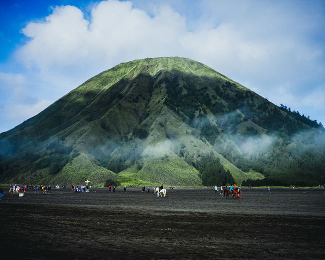 The best thing to do in Batok Mountain is trekking. It often becomes a special destination among tourists visiting Bromo Tengger Semeru National Park Indonesia, as well. It is fun to hike the mountain and the panorama is quite amazing too. Cloud - Sky Large Group Of People Day Mountain Vacations Travel Destinations Sky Outdoors Adults Only Nature Landscape Scenics People Only Men Adult Beauty In Nature Group Of People Mountain Range Beauty In Nature High Angle View Aerial View Rural Scene Erupting Nature Volcanic Landscape EyeEmNewHere Editor's Picks EyeEmNewHere Summer In The City