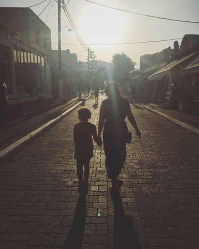 Sunbeam love Street Walking Two People Real People Full Length Transportation Built Structure Road Togetherness Architecture Outdoors Building Exterior City Day Women Childhood Bonding Sky Adult People