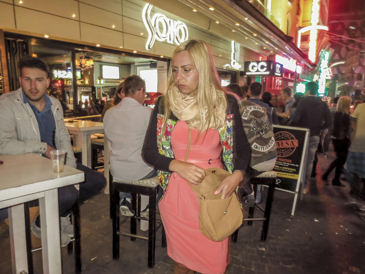 restaurant, three quarter length, casual clothing, cafe, illuminated, food and drink industry, standing, real people, communication, chair, lifestyles, night, indoors, neon, young women, young adult