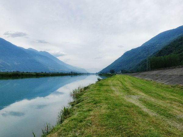 Had an awesome bike trip in Valtellina (my home valley) today 😍 Valtellina Valley Lombardia Water Reflections Canal Mountains Alps Velvia Fujifilm Nature On Your Doorstep