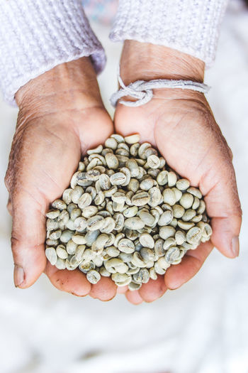 Arabica green bean coffee unroasted in old hand Close-up Day Directly Above Food Food And Drink Healthy Eating Holding Human Body Part Human Hand Indoors  Large Group Of Objects One Person People Real People