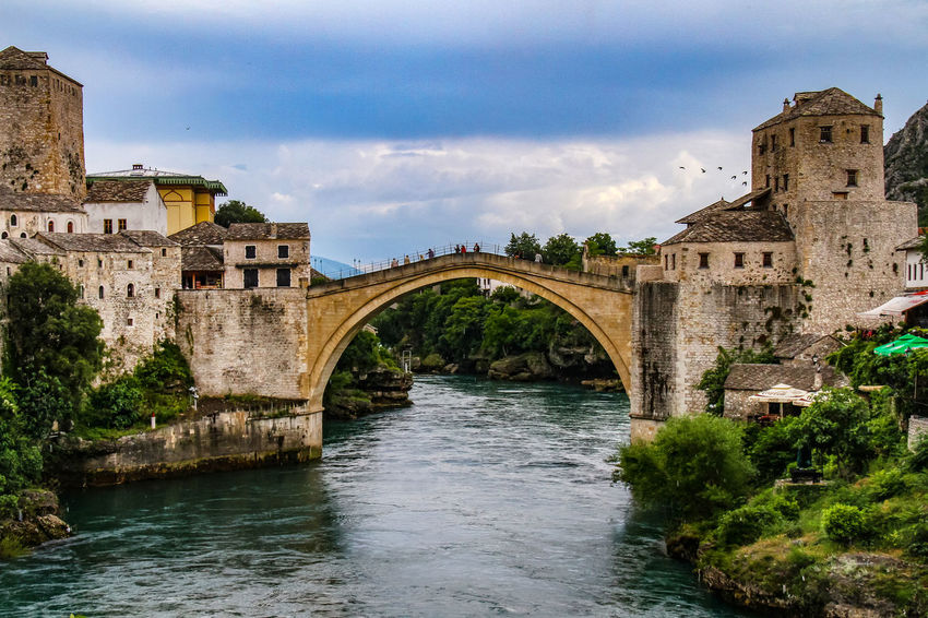 Mostar Mostar Bosnia Mostar Bridge Arch Architecture Bridge - Man Made Structure Building Exterior Built Structure Cloud - Sky Connection Day History Nature Neretva River No People Outdoors River Sky Travel Destinations Tree Water Waterfront