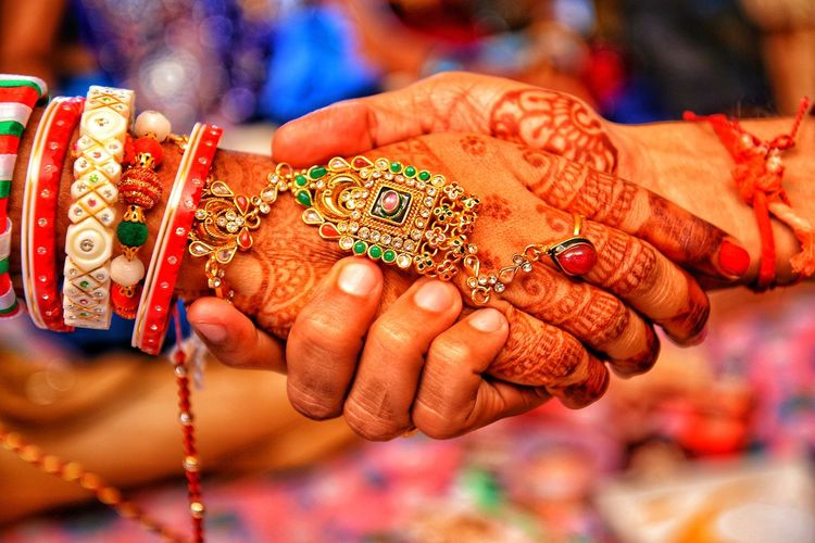 Holding hand Togetherness Together Indian Marriage Indian Culture  Human Hand Bride Bridegroom Women Ceremony Celebration Wedding Ceremony Fingernail Life Events Wedding Henna Tattoo Wedding Ring Bangle Engagement Ring Diamond Ring Engagement Jewelry Box Diamond - Gemstone Diya - Oil Lamp Finger Ring Platinum Wedding Vows Traditional Ceremony Indian Culture  Ring Groom