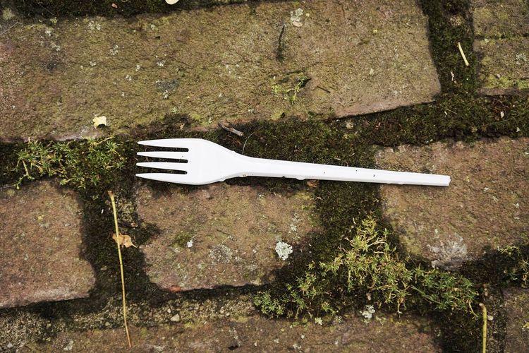 Plastic fork on cobblestones