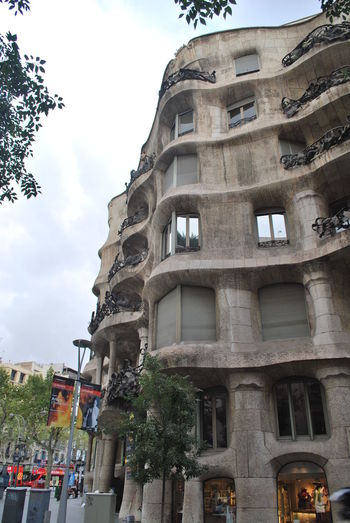 Architecture Barcelona Barcelona España Building Exterior Built Structure Casa Mila ( La Pedrera ) Casa Milà Gaudì City Cloud - Sky Day Gaudi History Low Angle View No People Outdoors Sky Travel Travel Destinations Tree