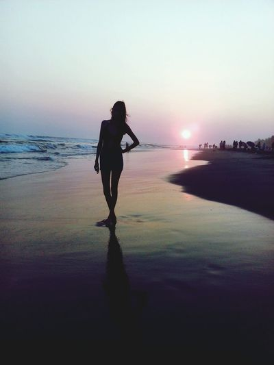 Reflection Full Length Sunset Beach Gun Night One Person People Adult Water Weapon Sea Outdoors Sky Standing Young Adult Silhouette One Woman Only Beauty Fashion