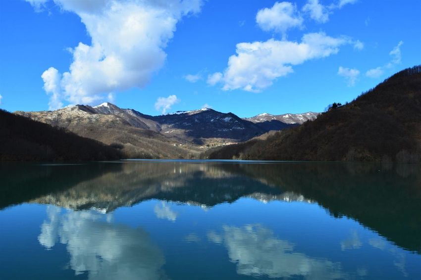 Lake Reflection Mountain Water Scenics Landscape Cloud - Sky Outdoors Blue Nature Sky Wilderness Beauty In Nature Mountain Range No People Forest Day Tree Italy