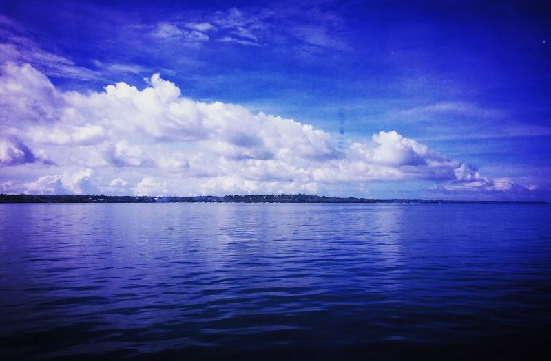 Arriving at Tagbilaran Port, the view from my cabin window was bluer than blue. Sky Cloud - Sky Nature Sea Blue Cloud Scenics Water Tranquility Outdoors No People Waterfront Beauty In Nature Tranquil Scene Day Horizon Over Water Travel
