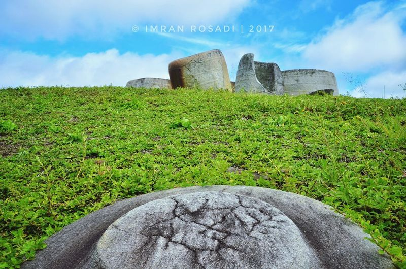 Megalith Rock, Lore Lindu National Park, Poso, Central Celebes, Indonesia #megalith #megalithstone #nationalpark #History #Indonesia #lorelindunationalpark Cloud - Sky History Grass Outdoors Agriculture Day Nature Sky