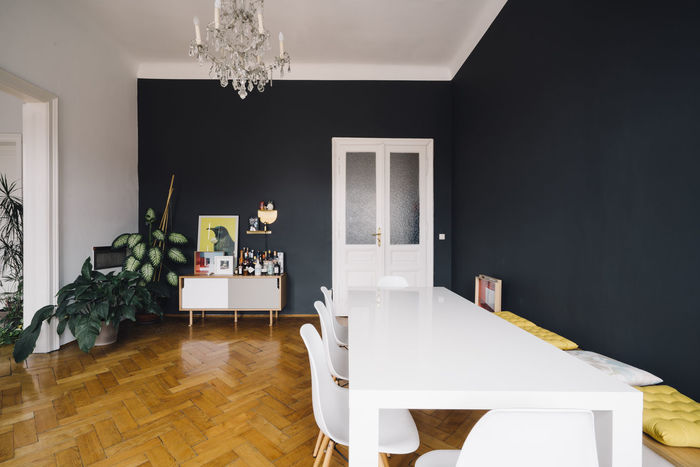 Dining Room with table, chairs and sideboard Dining Room Plants Black Wall Chair Chandalier Day Design Dining Room Table Domestic Room Door Furniture Hardwood Home Interior Home Showcase Interior Indoors  Inteior Luxury Modern No People Table White Chairs White Chairs And Table White Table