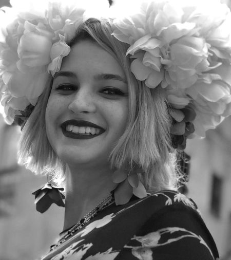 Close-up portrait of smiling woman with flowers