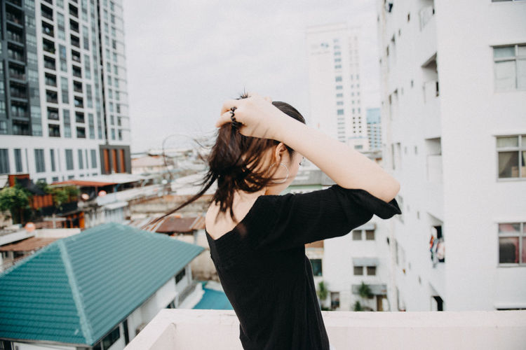 Building Exterior Architecture Built Structure City One Person Focus On Foreground Young Adult Young Women Real People Standing Women Hair Hairstyle Lifestyles Long Hair Tousled Hair Wind Beautiful Woman Hair Toss Outdoors Adult