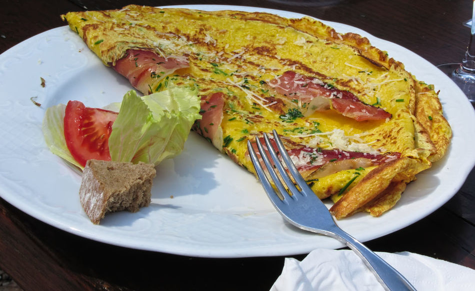 Omelet with speck, cheese and herbs Alpe Di Siusi Bread Cheese Dishware Eggs Fast Food Food Fork Fried Eggs Herbs Italian Food Meal No People Omelet Plate Savory Food Scrambled Eggs Served Serving Size Snack Speck Tomato Tyrol