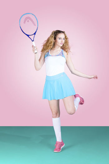 Color Fashion Front View Full Length Green Headband Indoors  Lifestyles Looking At Camera One Person People Pink Pink Color Pop Of Color Portrait Pose Sport Sport Style Sports Clothing Studio Studio Shot Tennis Tennis Racket Young Adult Young Women