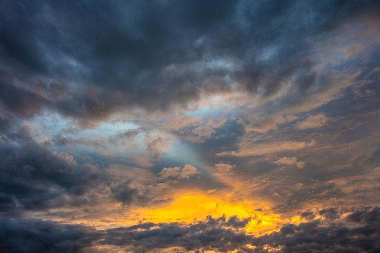 Sunset sky background with clouds Sunrise Clouds Cloud - Sky Sky Beauty In Nature Sunset Scenics - Nature Dramatic Sky Cloudscape Nature Tranquil Scene Orange Color Multi Colored Tranquility Environment Idyllic Overcast Moody Sky Meteorology Storm No People Outdoors