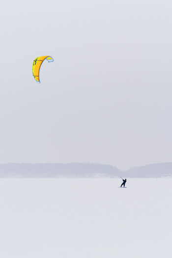 Sport Adventure Extreme Sports Leisure Activity Outdoors Winter Sport Winter Kiteboarding Snowboarding Exploration Kitesurfing Kitesurfer Snow Frozen Lithuania Kaunas Snowstorm Alone Brave Extreme Weather Flying Freedom One Person Kite Lifestyles