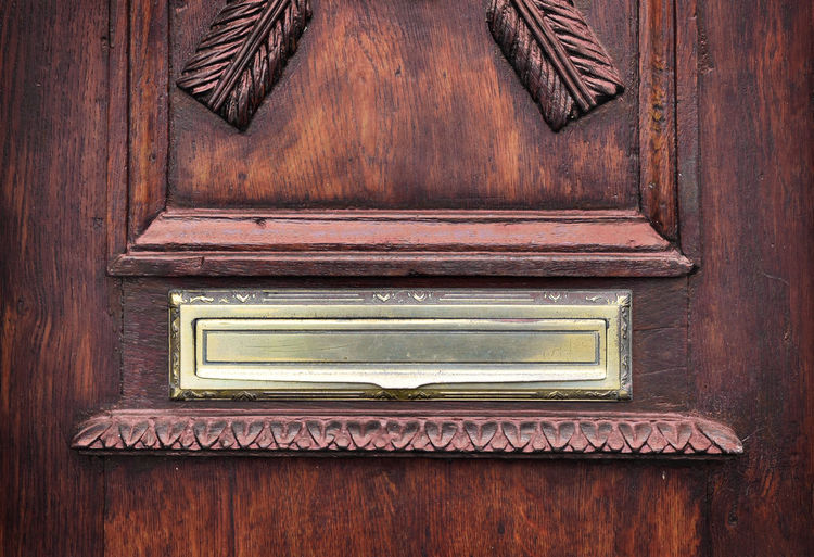 Letter slot in an old wooden door. Slot Antique Brown Close-up Communication Correspondence Door Entrance Frame Indoors  Letter Letter Slot Letterbox Mail Mail Slot Mail Slots Mail Mailbox No People Old Old Door Ornate Rectangle Retro Styled Technology Wood - Material
