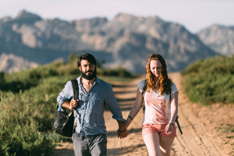 Young couple walking on mountain