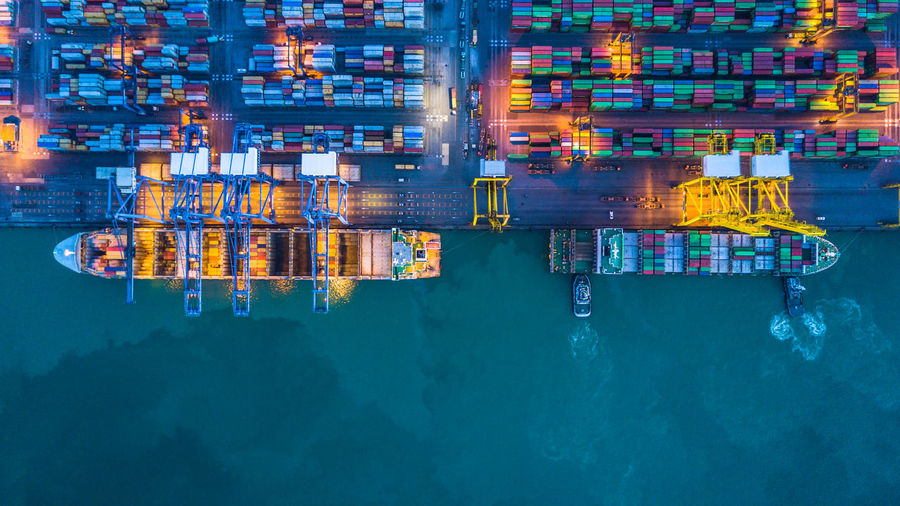 High Angle View Of Illuminated Container Ship At Commercial Dock