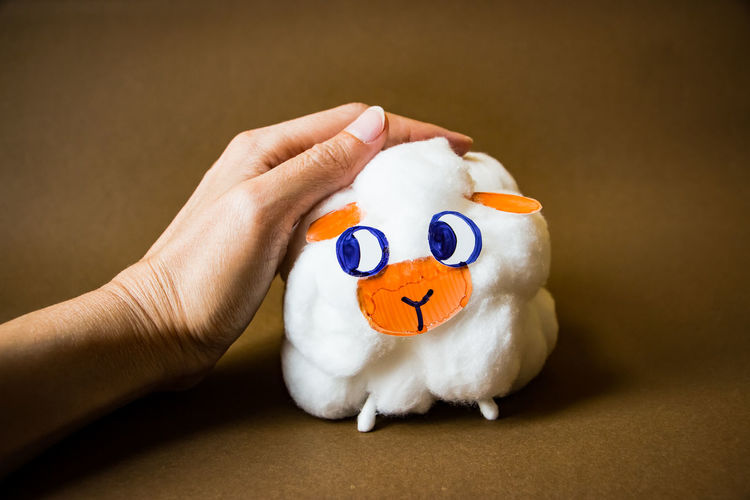 DIY handmade cute sheep from cotton balls Cotton Balls DIY Lamb Activity Art Close-up Craft Handmade Holding Human Body Part Human Hand Lost Sheep One Person People Sheep Stuffed Toy Toy