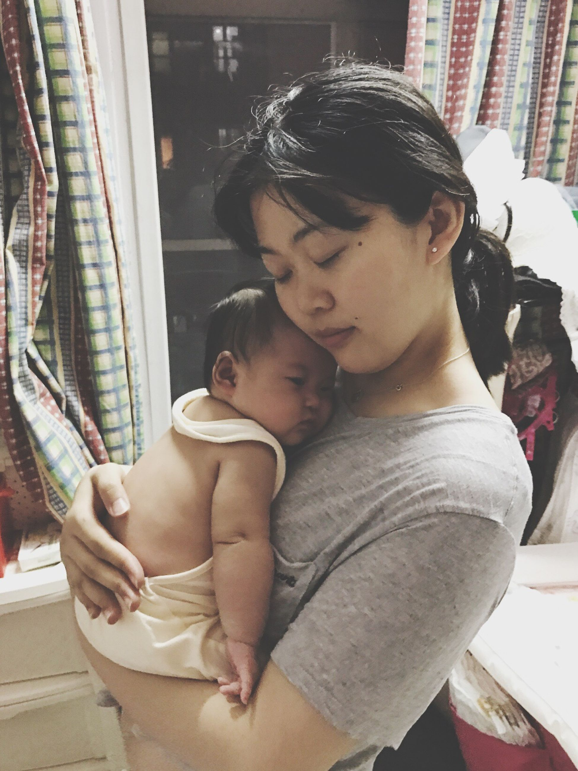 baby, real people, love, babyhood, family with one child, day, casual clothing, togetherness, indoors, childhood, lifestyles, bonding, young adult