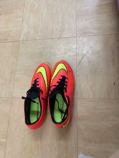 Blind Photographer Walk In Someone Else's Shoes Football Boots Orange Trainers Nike Hypervenom Nike✔ EyeEm Selects Shoe Pair High Angle View Multi Colored Flooring Sandal Sports Shoe Still Life Directly Above No People