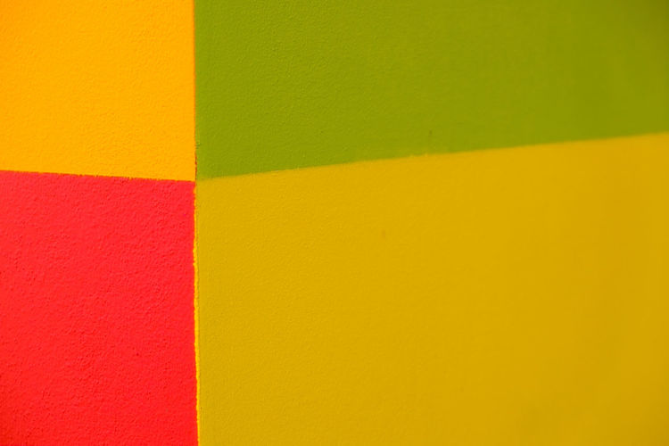 Abstract geometric pattern on concrete wall Architecture Backgrounds Built Structure Close-up Copy Space Full Frame Green Color Indoors  Multi Colored No People Orange Color Pattern Pink Color Purple Red Textured  Vibrant Color Wall Wall - Building Feature Yellow