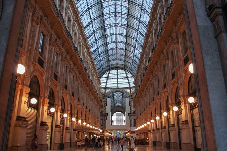 People Walking At Illuminated Galleria Vittorio Emanuele Ii