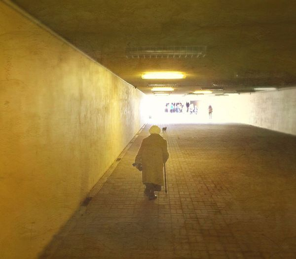 Blurred motion of woman in tunnel