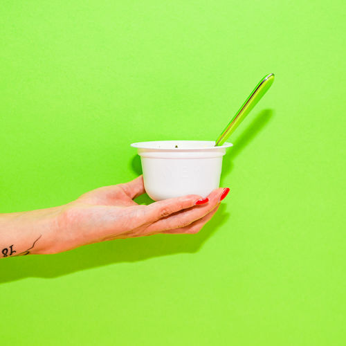 Modern Yogourt Colors Modern Studio Adult Almond Backgrounds Cereal Plant Color Colored Background Copy Space Cup Disposable Disposable Cup Drink Drinking Straw Finger Flash Flat Lay Food And Drink Fruit Glass Green Background Green Color Hand Holding Human Body Part Human Hand Indoors  Neon One Person Refreshment Studio Shot