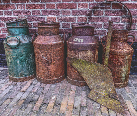 4 old milk churns Brick Wall Bricks Close-up Farm Farm Life Milk Churn No People Nostalgia Outdoors Pair Plough Rusty Still Life Still Life Photography