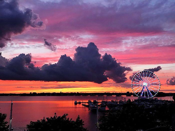 National Harbor at sunset. Sunset Sky Ferris Wheel Amusement Park Ride Amusement Park Cloud - Sky Arts Culture And Entertainment Beauty In Nature Orange Color Wheel Sea Water Scenics - Nature First Eyeem Photo
