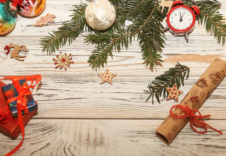 still life Holiday indoors decoration Art and Craft wood - material Celebration Creativity high angle view christmas decoration directly above christmas ornament paper clock Chr Copy Space Still Life Holiday Indoors  Decoration Art And Craft Wood - Material Celebration Creativity High Angle View Christmas Decoration Directly Above Christmas Ornament Paper Clock Christmas Merry Christmas No People Happy New Year Christmas Lights