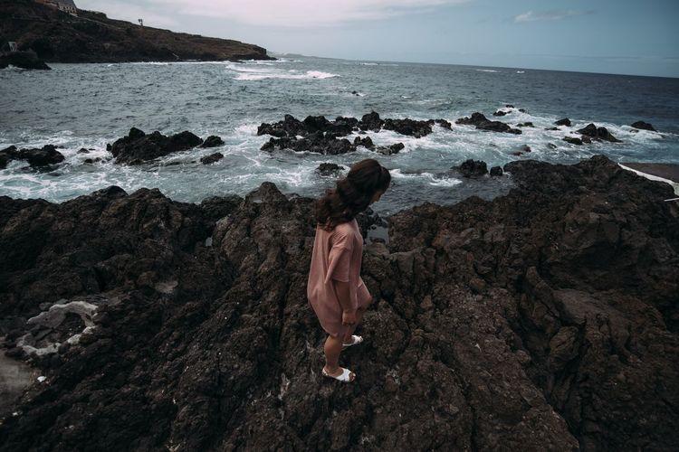 Woman looking at sea shore