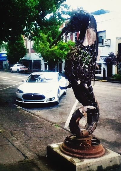 ... because it's not every day you see a Tesla Model S parked by a Giant Steel Seahorse Sculpture. Streamzoofamily LongviewWA Pacific Northwest  Feel The Journey Art Historic Downtown Longview Feel Tje Journey