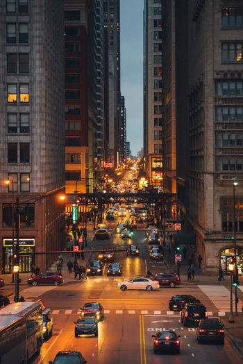 Chicago City Life City Street Cool Night City Night Lights Architecture City City Lights City View  Cityscape Downtown District Dusk In The City Evening City Evening Time Headlights Illuminated Milenium Park Street Taxis The Loop Train Transportation Urban Life
