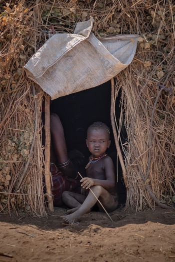 Portrait Photography Ethiopia Africa African Ethiopian Dassanech Tribe Portraits Omo Valley Ethiopian Photography 🇪🇹 Tribal Tribes Tribe Childhood Child Social Issues Nature People Sitting Toy Clothing Human Representation Outdoors Architecture Baby Wood - Material Offspring Innocence Portrait Land Day