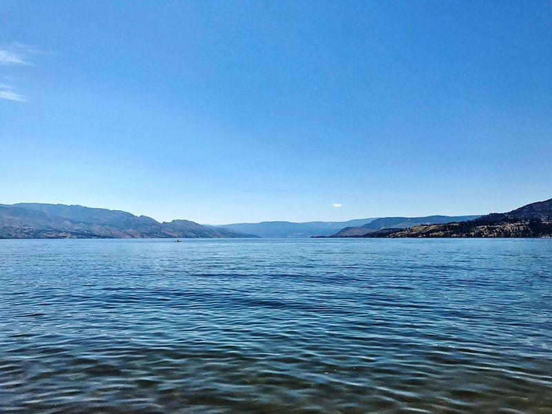 Mountain Scenics Beauty In Nature Tranquil Scene Blue Nature Outdoors Tranquility Copy Space Clear Sky Okanagan Lake Kelowna No People Lake Water Day Waterfront Landscape Sky