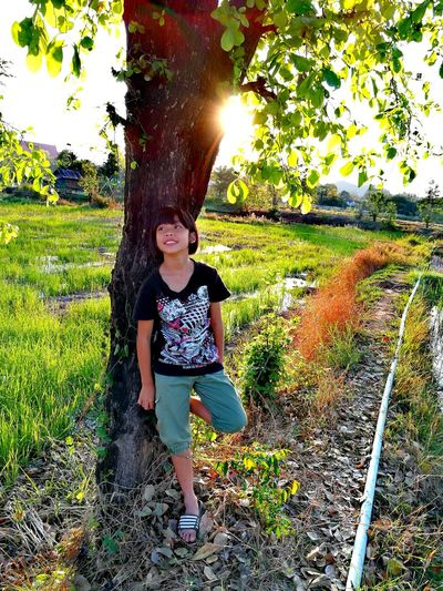 Girls Standing Tree Standing Full Length Smiling Young Adult Only Women One Person Grass Real People Growth Sunlight Childhood Nature Tree Children Only Beauty In Nature Thailand🇹🇭 2018 Day Outdoors Green Color Farm Young Women EyeEmNewHere