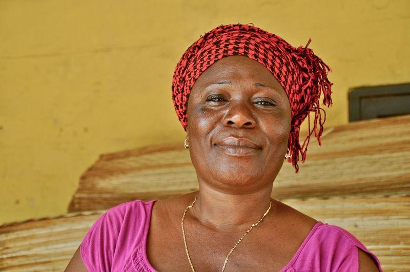 Portrait of smiling woman against house