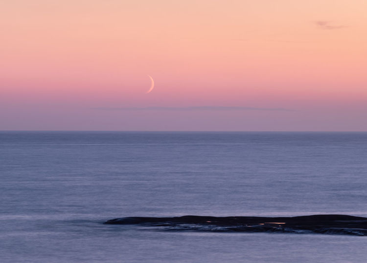 New moon just after sunset. Sea Sky Horizon Horizon Over Water Beauty In Nature Water Sunset Scenics - Nature Tranquility Nature Tranquil Scene No People Environment Outdoors Idyllic Newmoon Moon Moonset Twilight Ocean Long Exposure EyeEmNewHere