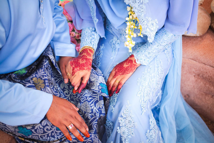High Angle View Of Newly Wed Couple Sitting On Seat