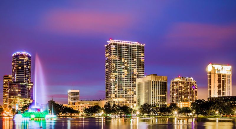 Architecture Building Exterior Illuminated Built Structure Skyscraper Waterfront Night Water Reflection Sky Modern River City Outdoors Urban Skyline No People Cityscape Low Angle View Tree Lake Eola Lake Eola Park Orlando Orlando Florida Downtown Downtown Orlando