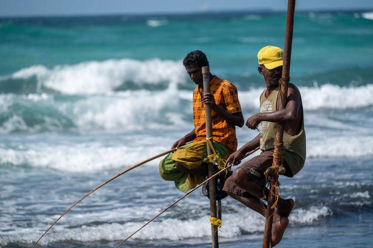 Men sitting on beach