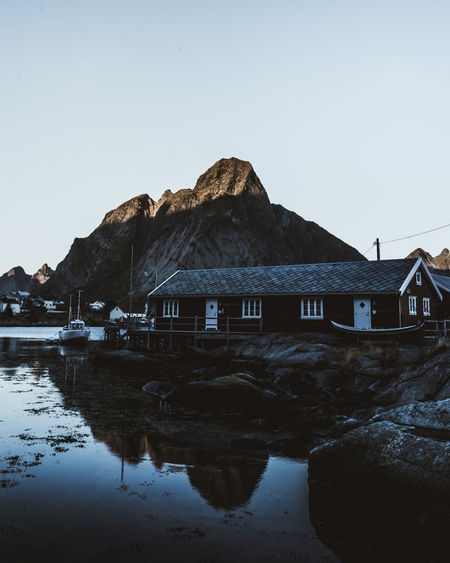 Moody Reine in the early morning Norway Architecture Beauty In Nature Building Exterior Built Structure Clear Sky Day Fishermen's Life House Lofoten Moody Mountain Nature Nautical Vessel No People Outdoors Reflection Rock - Object Rocks And Water Scenics Sky Tranquil Scene Tranquility Water Waterfront